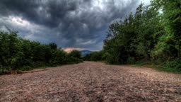 Rain Clouds Over A Mountain Lonely Road. Crimea, Ukraine. HDR Time Lapse Shot Motorized Slider