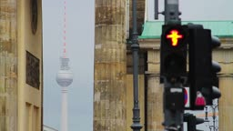 Traffic lights in front of Brandenburg gate with TV tower in distance