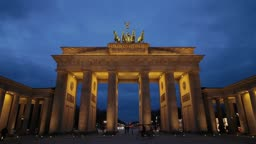 Time lapse night shot of Brandenburg gate in Berlin one of the most well known landmarks of Germany
