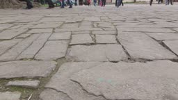 Ancient cobblestone pavement in old town dolly shot