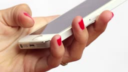 Woman in the office chatting and sending messages with her smart phone.Clerk on mobile whatsapp conversation.Female phone conversation at work.Corporate Business scene with an employee holding a phone conversation.Cellular phone chatting at wo