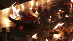 Burning candles in the Indian temple. Diwali GCo the festival of lights.