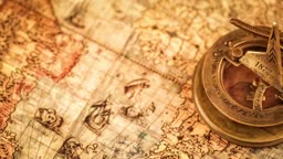 Vintage still life. Vintage magnifying glass lies and compass on ancient world map in 1565.