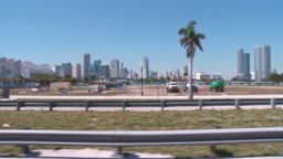 View of the skyline of Miami shot from a car with traffic in the foreground