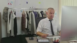 Successful Confident Businessman Fashion Designer Working With Computer In Office