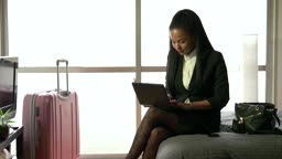 Multi-ethnic Businesswoman Woman Working With Computer Hotel Room Business Travel
