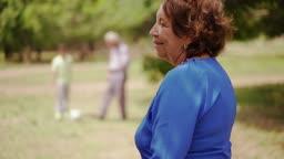 11-Happy Senior Grandma Playing Soccer With Family