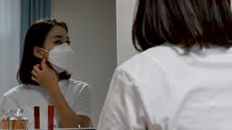 일상 생활 속 마스크 집에서 마스크 착용하는 젊은여자 모습