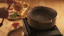 겨울음식 끓는 물에 육수 넣는 모습